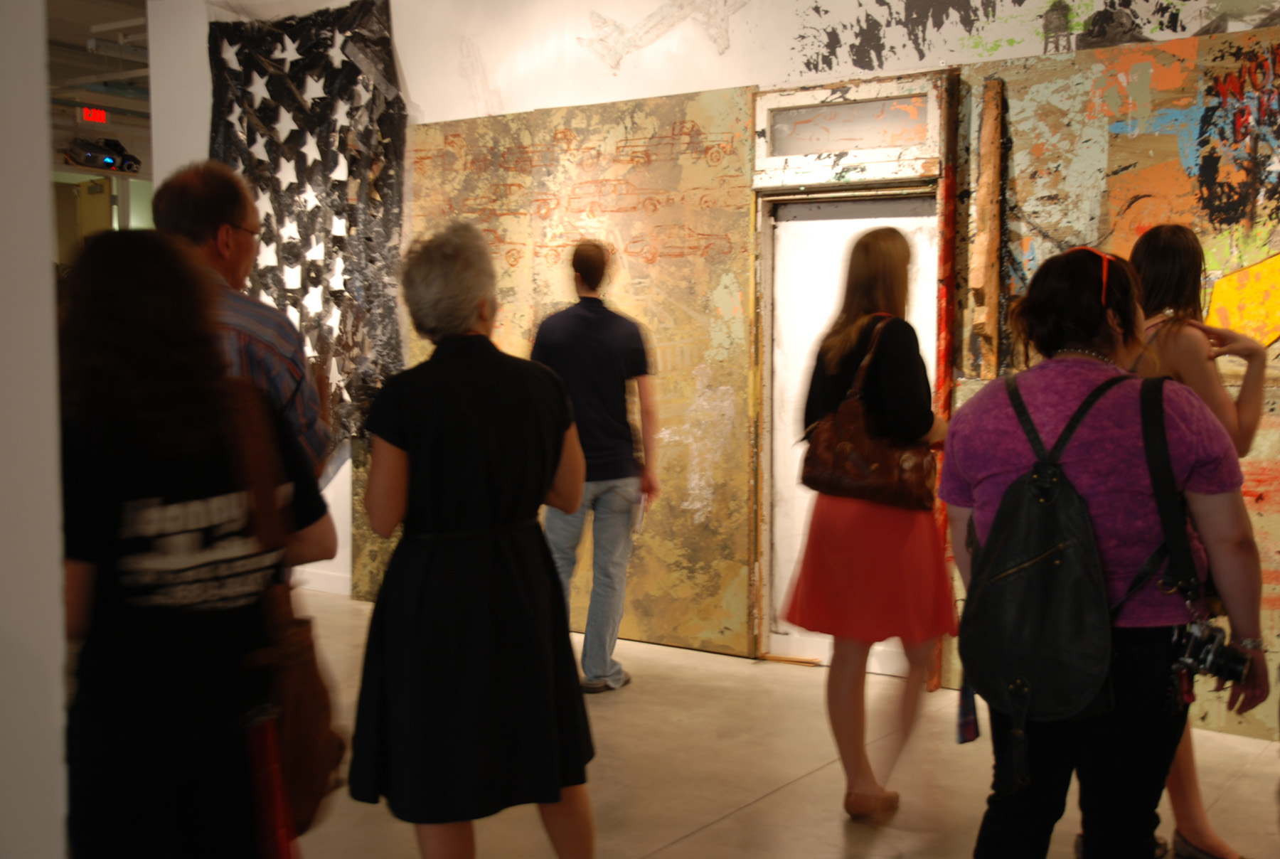 People touring art gallery
