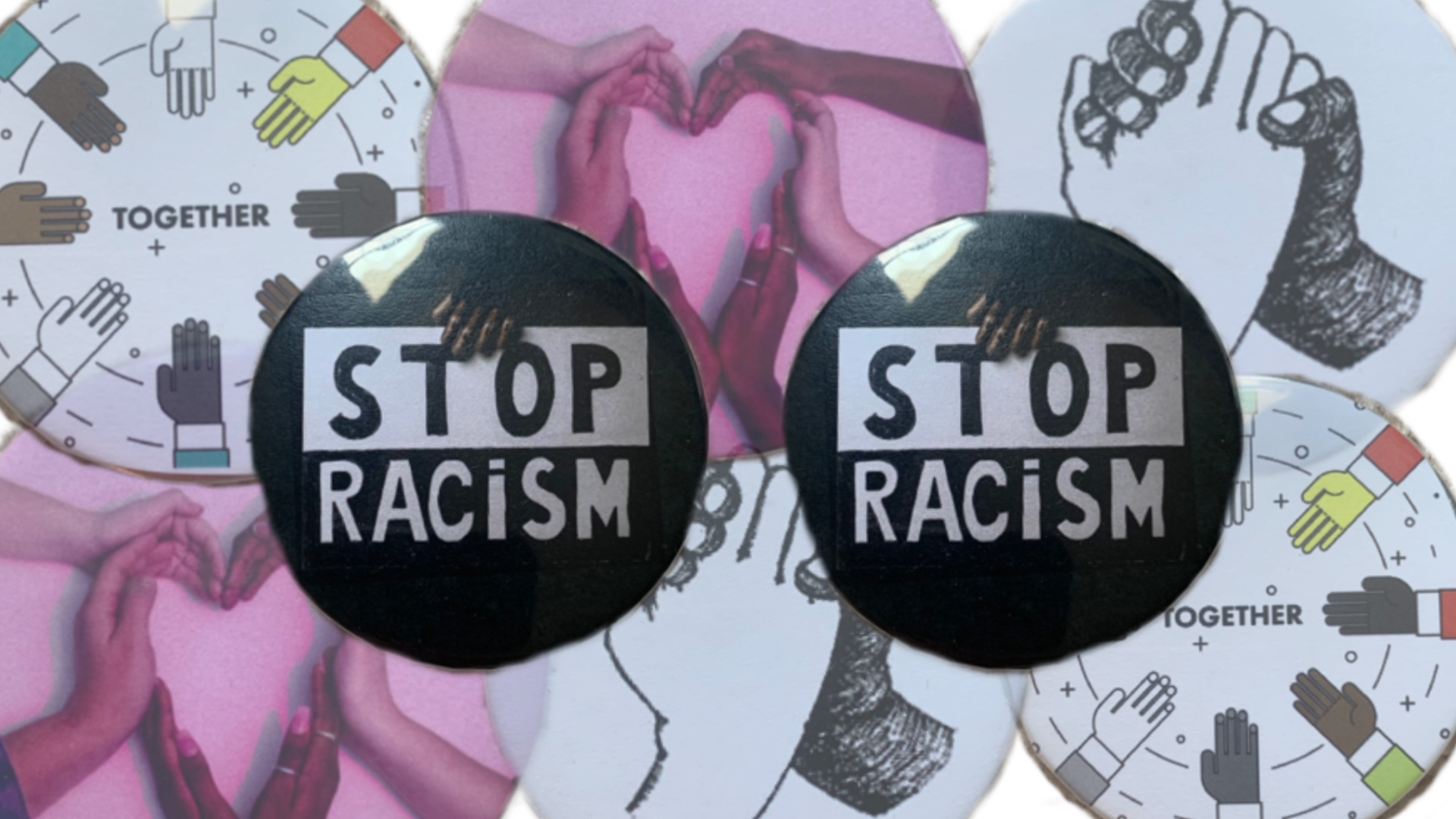 "two buttons that sat ""Stop Racism"""