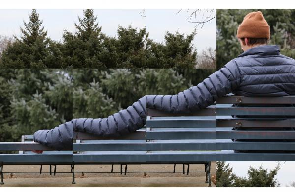 Promo image for Nobody There, features man sitting on a bench but one arm is photoshopped to be very long