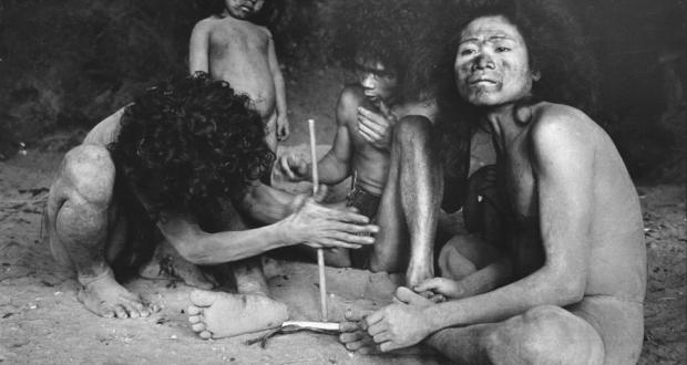 "Image of John Nance: ""Making a Fire,"" black and white photography, 1972-1974"