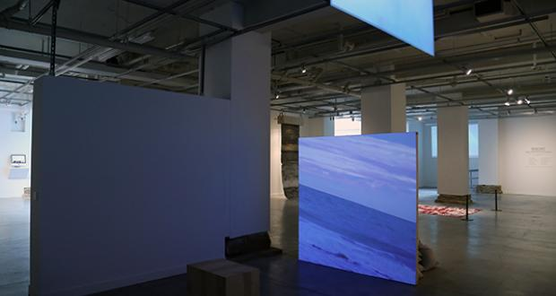 "Liam Ze'ev O'Connor: ""Shamayim (there are waters),"" video loop, drywall, wood, 2 tons of sand, 2015"