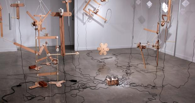 """Image of Andrew Frueh: """"Echo of Motion,"""" laser-cut plywood, 3D printed PLA, nuts, bolts, wood dowels, bricks, string, 2014"""