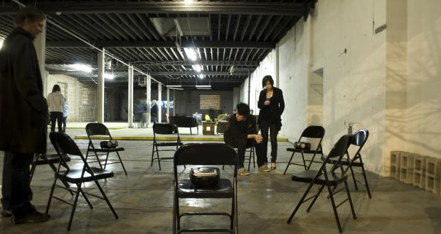 Brian Keith Sharrock, Untitled (come listen to yourselves), CD players, sound, metal chairs, video projection, 2009 – 2010