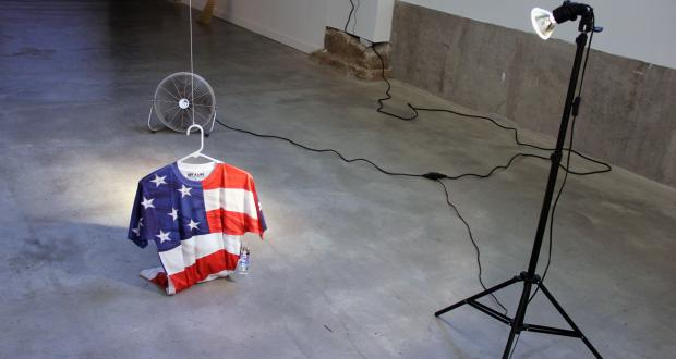 "Image of Andres Felipe Castelblaco Olaya: ""Free (or get a life),"" video, monitor, t-shirt, fan, 2013-2014"